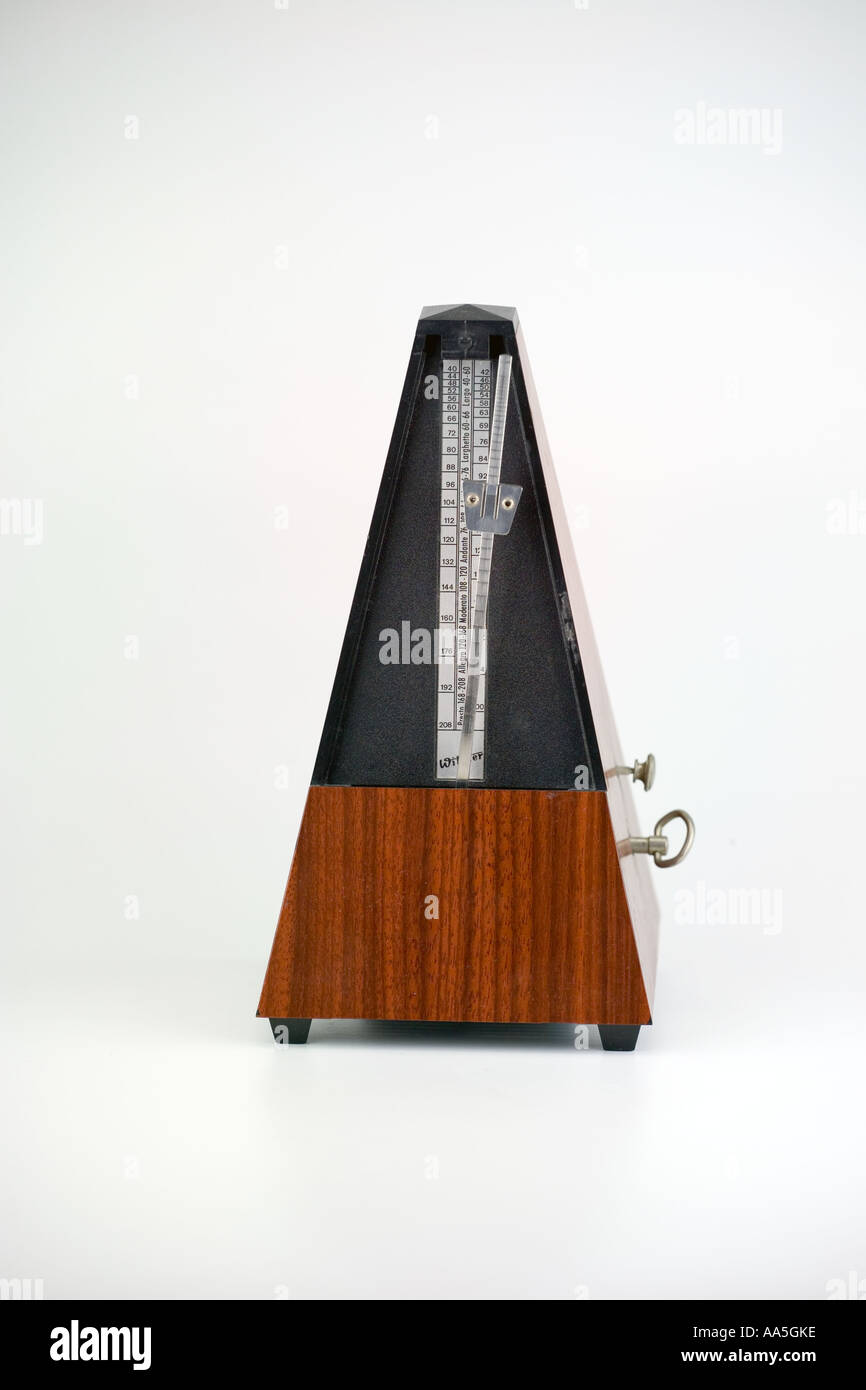 Metronome is a clockwork device is used for marking musical tempo - Stock Image