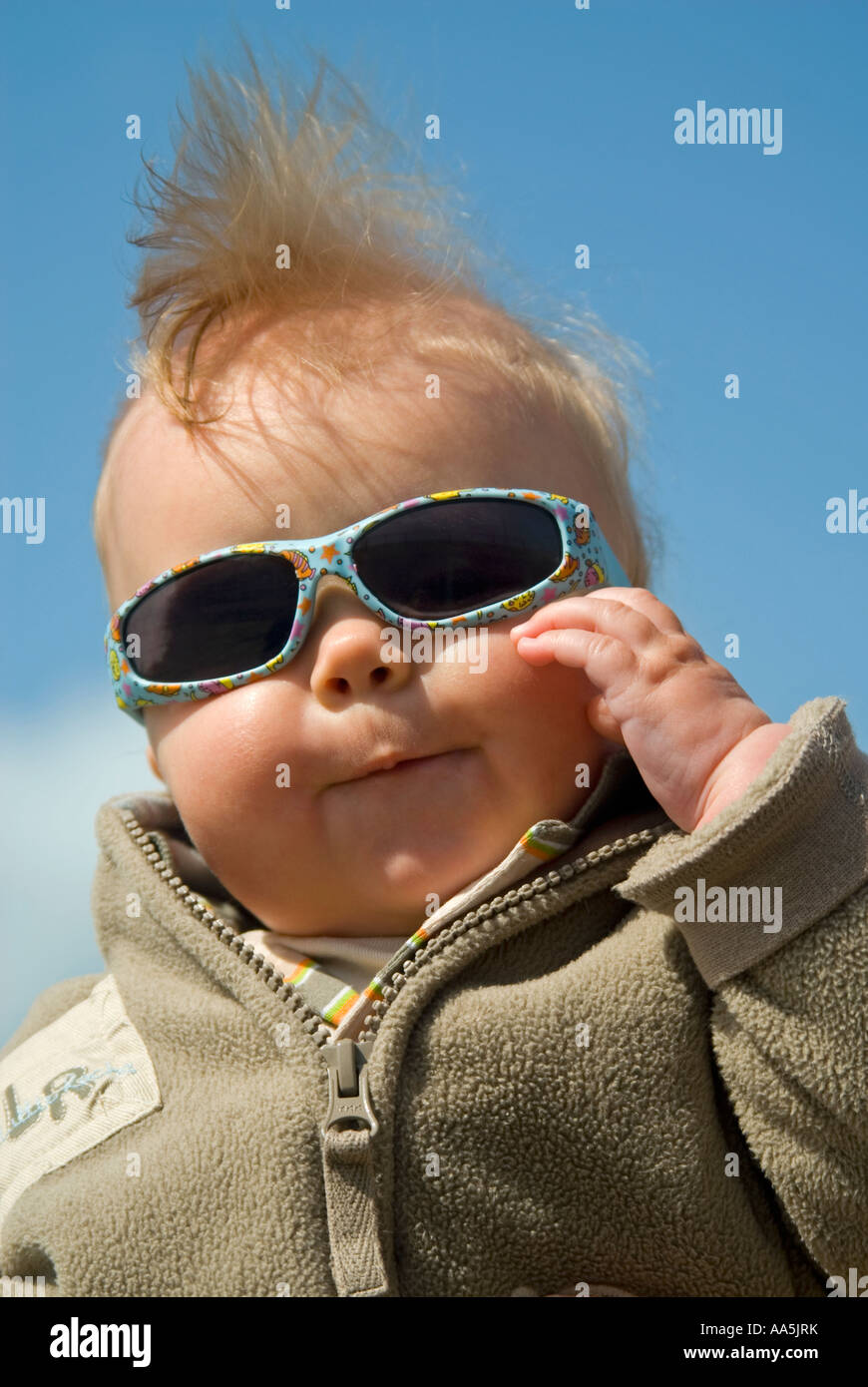 humorous vertical close up of a 6 month old baby boy posing for