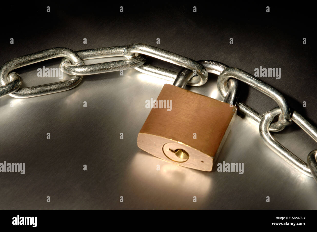 Chain and closed padlock - Stock Image