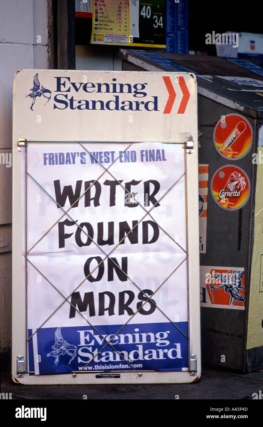 Water Found on Mars: Headline on London Evening Standard newspaper sales sign before shop, London - Stock Image
