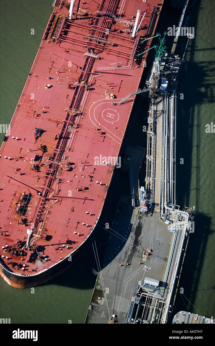 Aerial above petroleum tanker docked at  Chevron long wharf Richmond, San Francisco bay Stock Photo