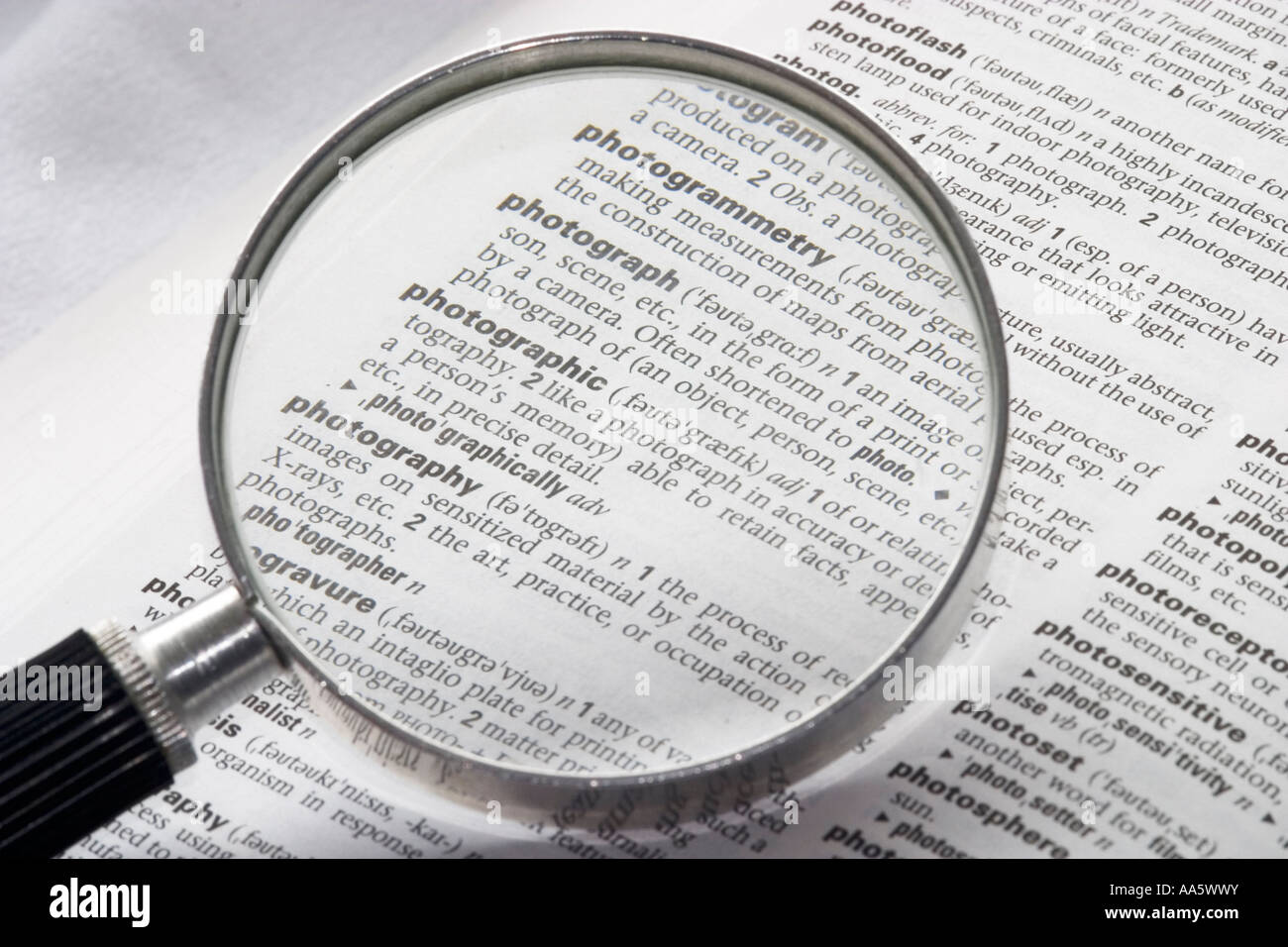A Black And White Image Of A Magnifying Glass On An Open