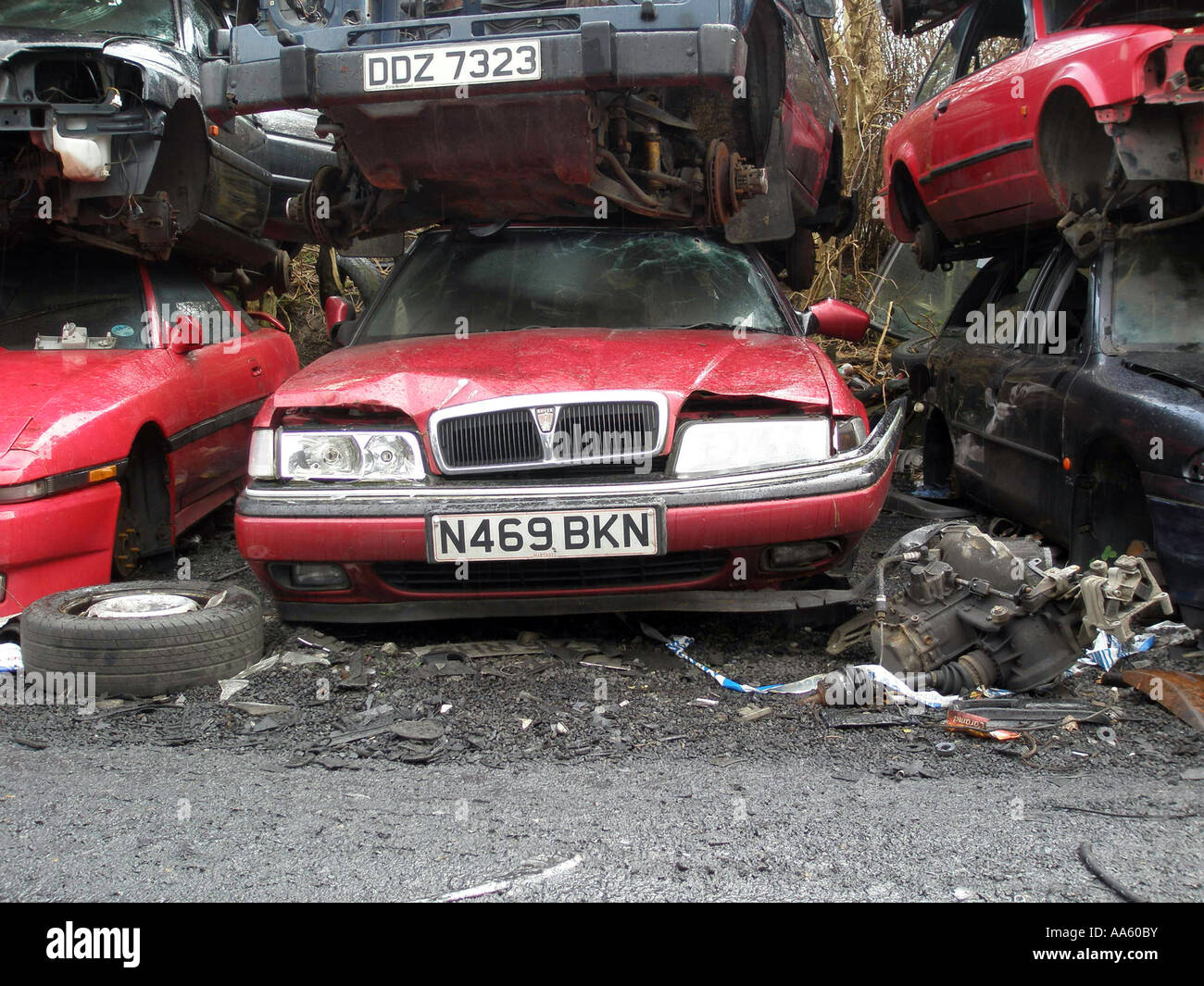wrecked Rover 800 at the bottom of a stack of cars in a scrapyard ...