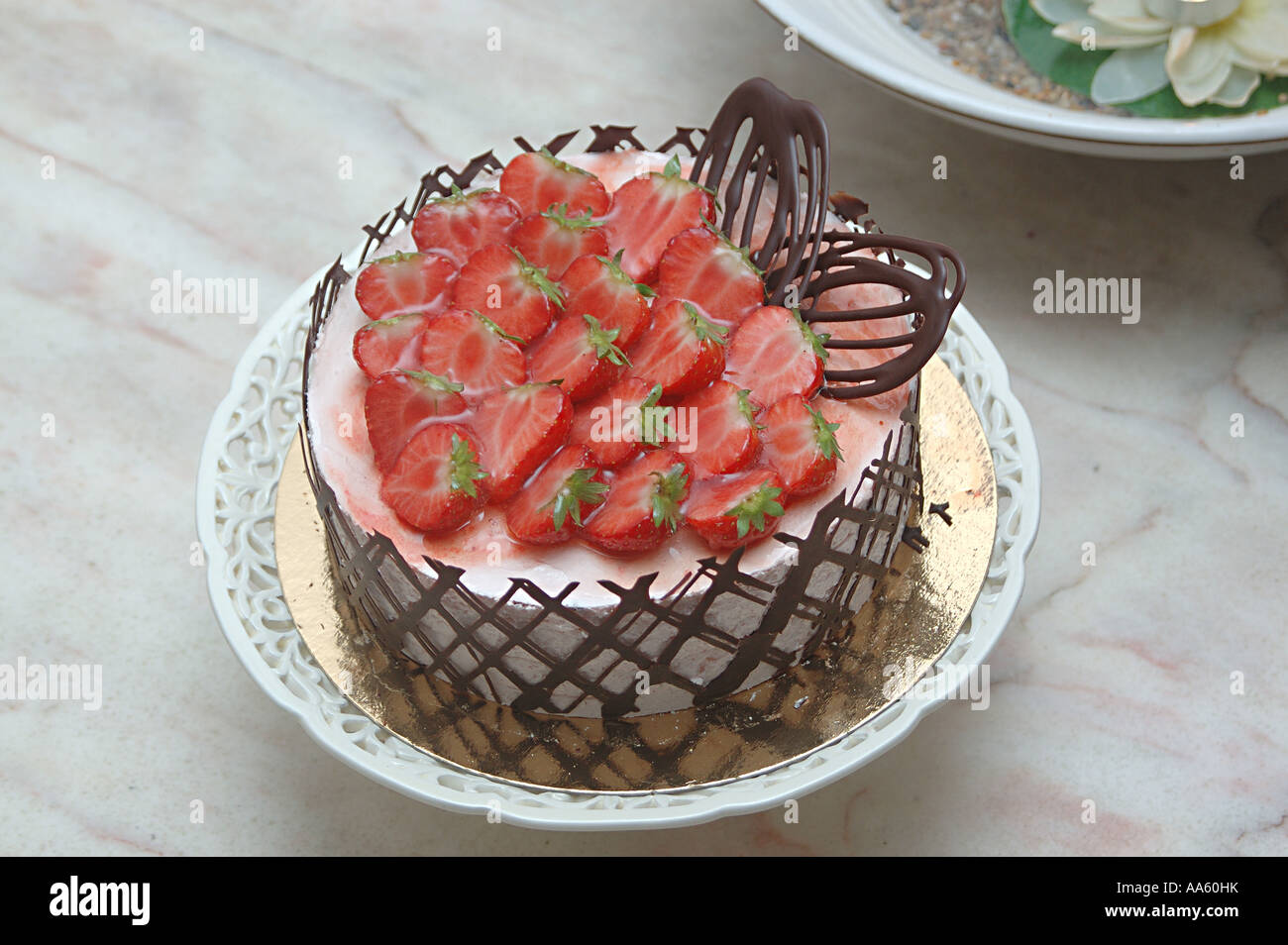 Strawberry Mousse Cake Decorated With Strawberry And Chocolate Net