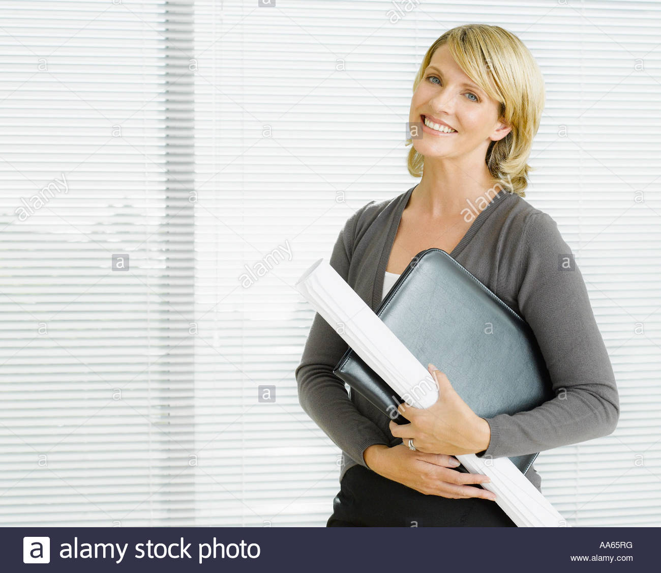 Businesswoman with blueprints - Stock Image