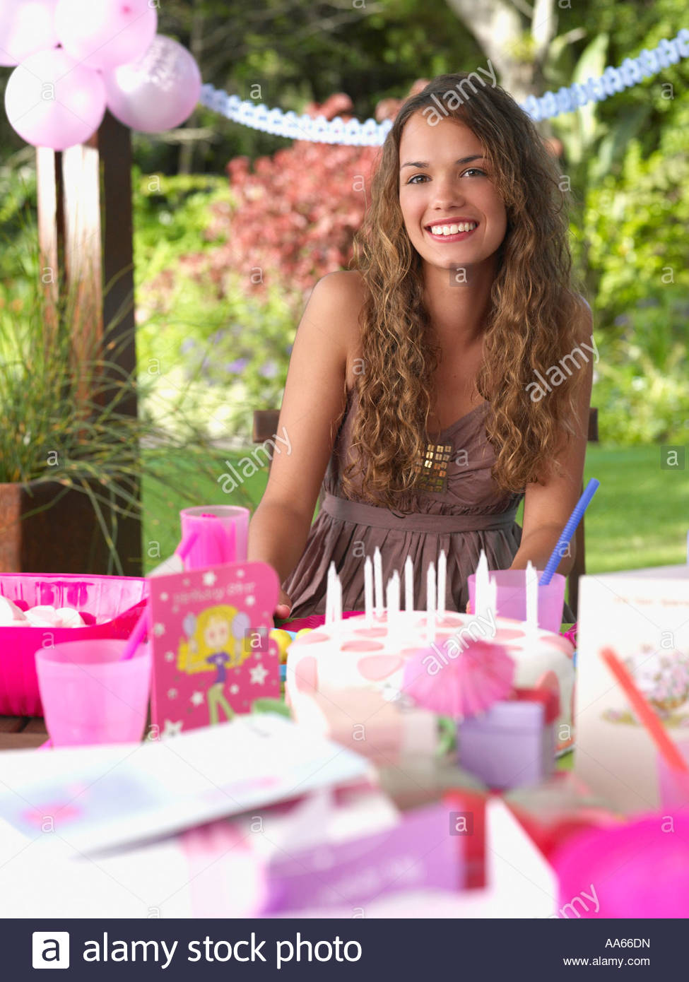 Teenage girl at birthday party smiling outdoors - Stock Image
