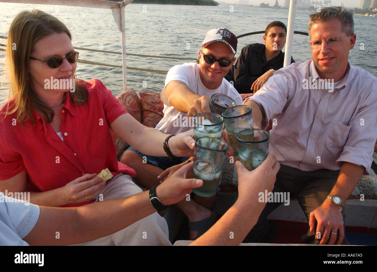 Major Rebecca Holt Tina Holt red shirt who is the wife of SGT Brett Long and LCDR Dr Daniel E Szumlas glasses take a felucca - Stock Image