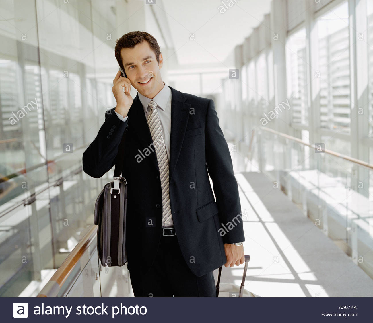 Male business traveler talking on cell phone Stock Photo