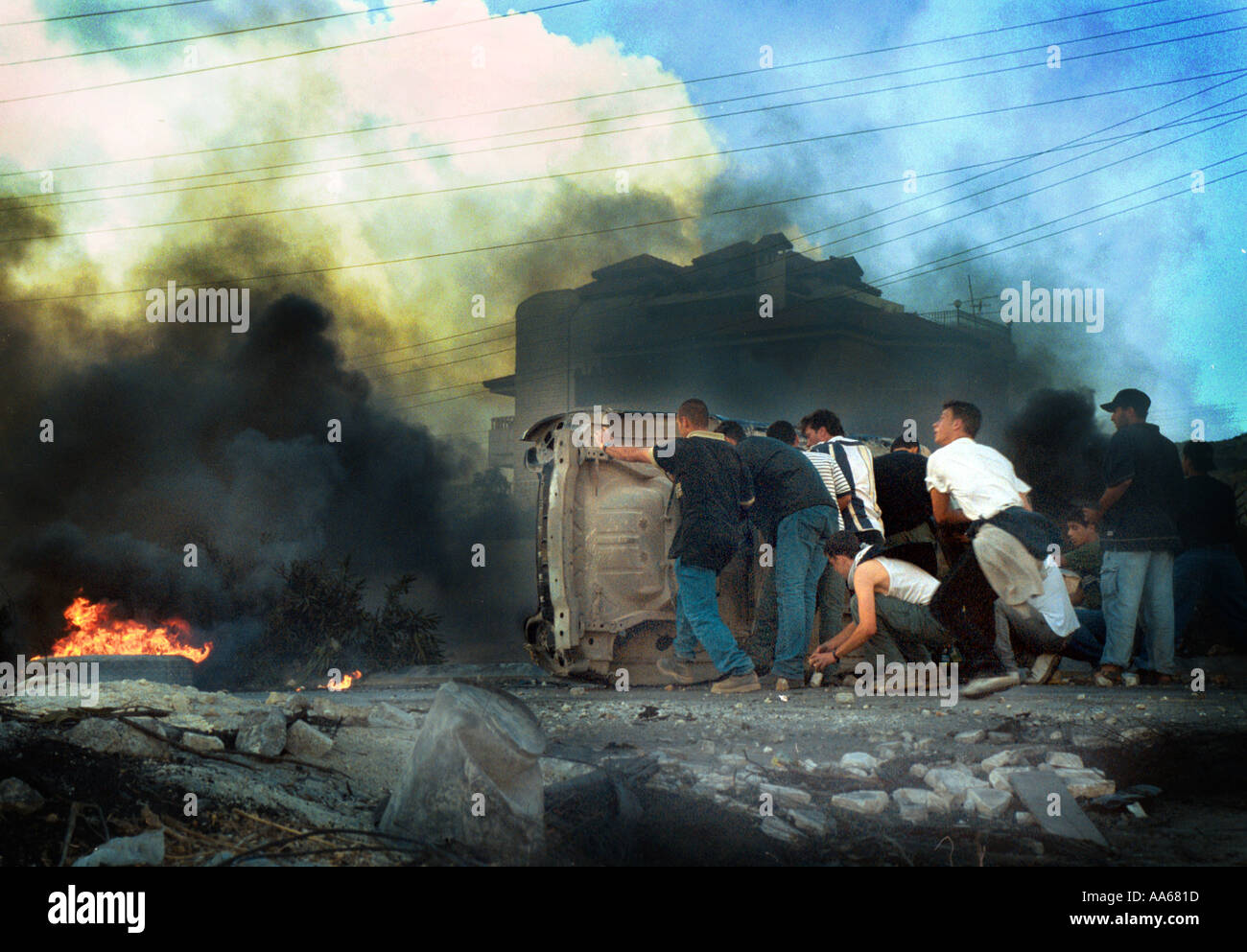 Palestinians express their rage towards the Israeli army in the West Bank town of Ramallah October 11 2000 Guns are still - Stock Image