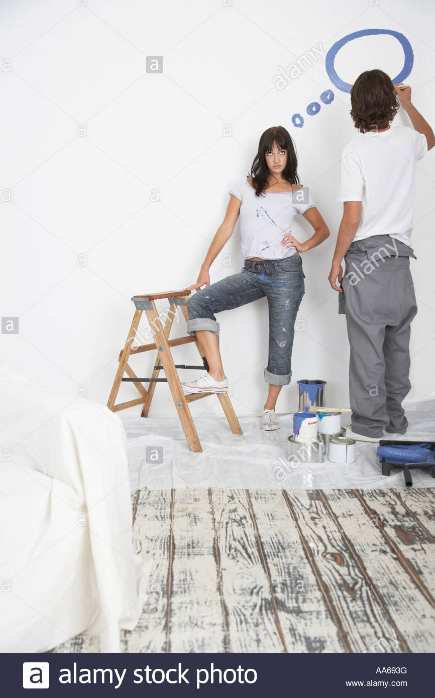 Man and woman painting thought bubble - Stock Image