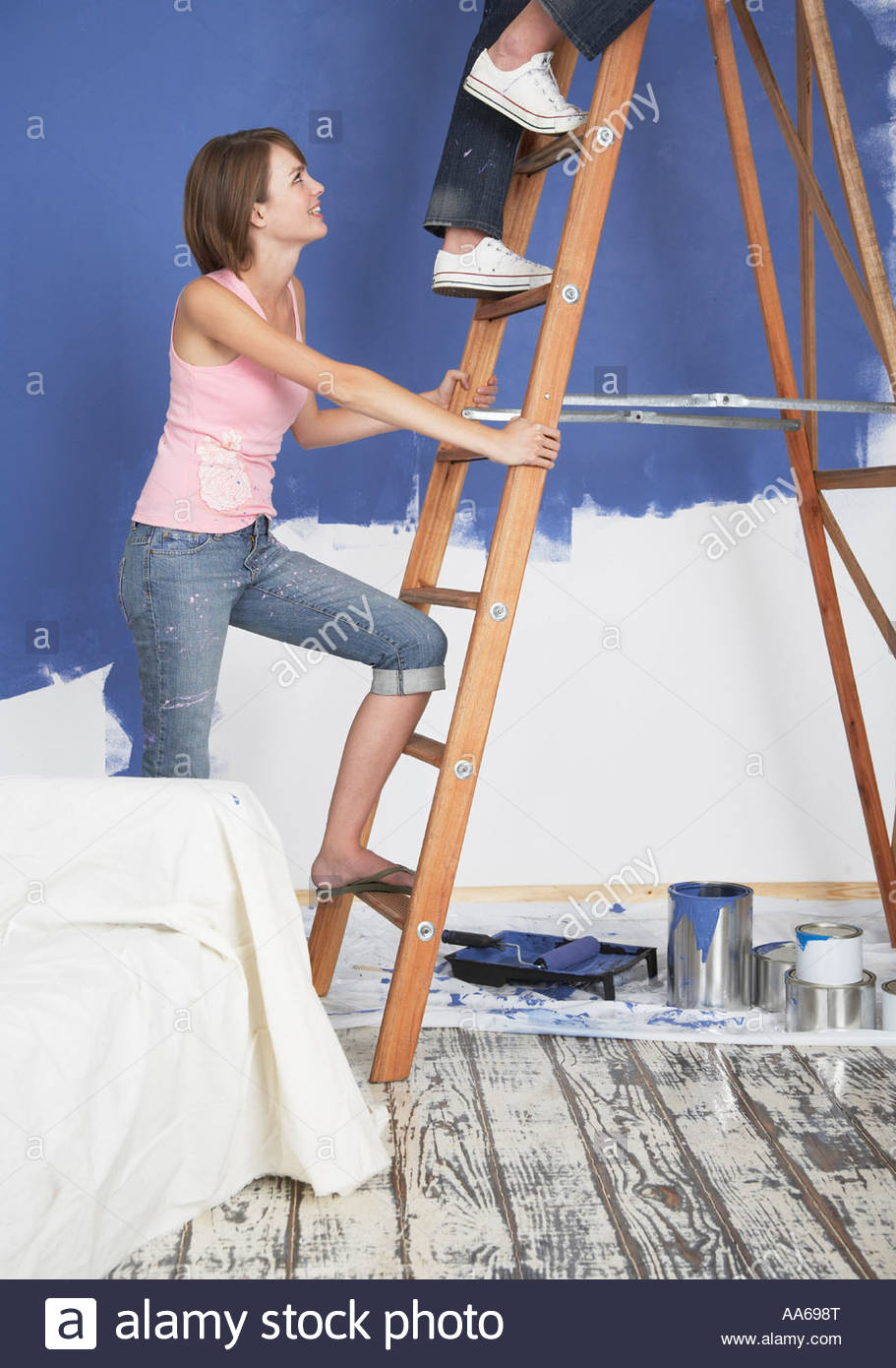 Woman painting home - Stock Image