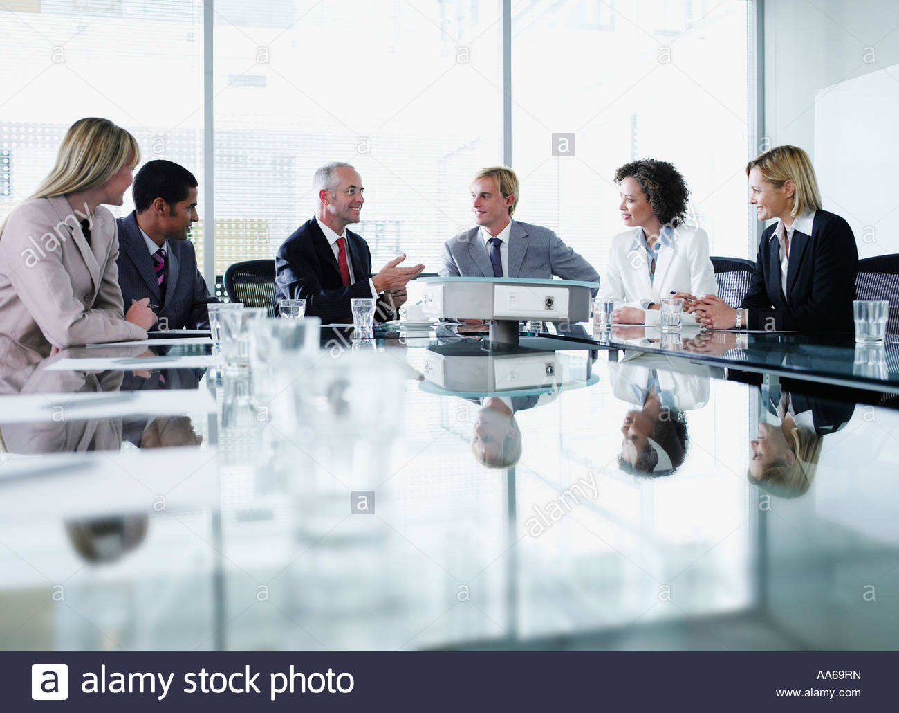 Group of office workers in a boardroom meeting - Stock Image