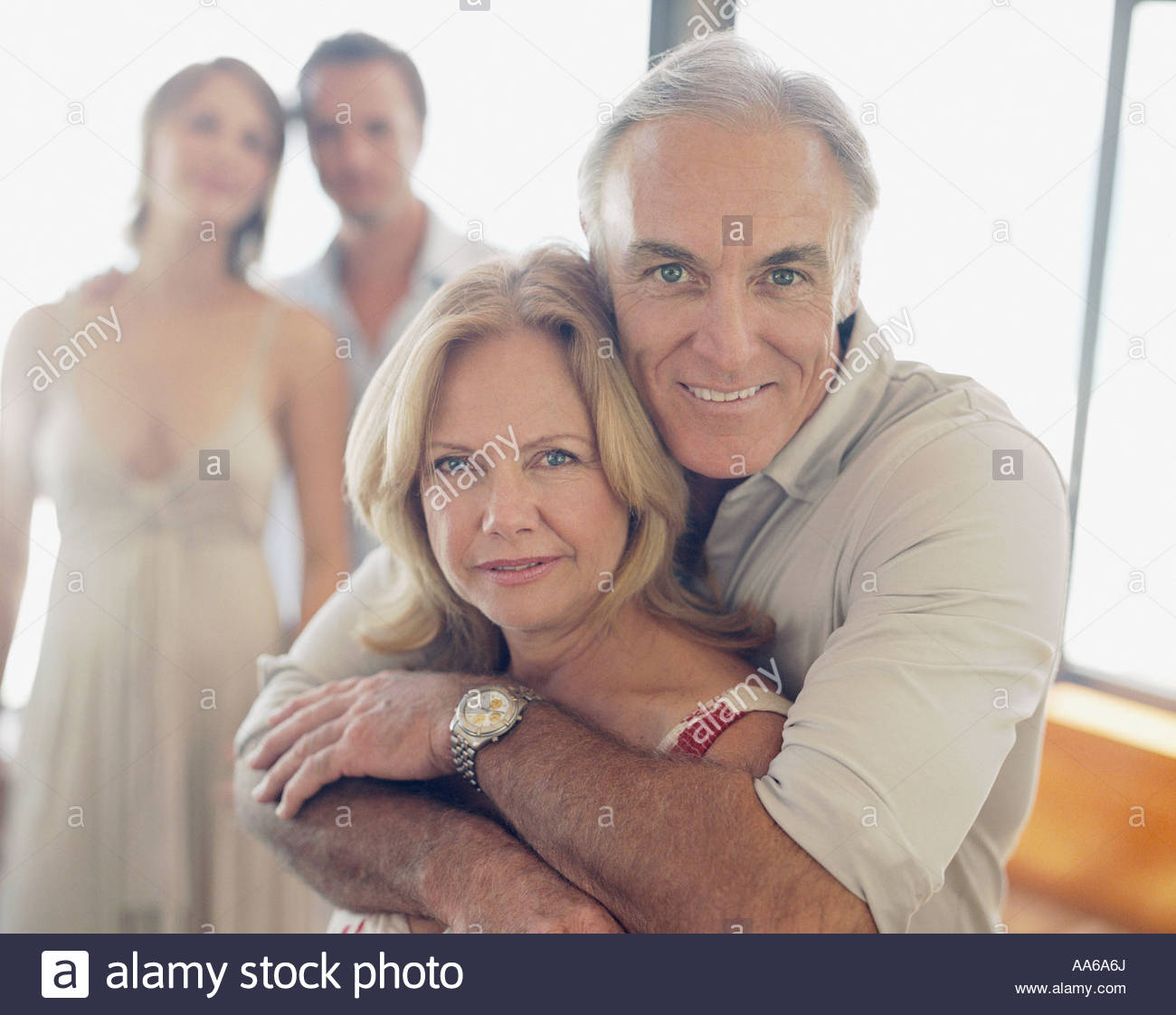 Mature couple with younger couple in background - Stock Image
