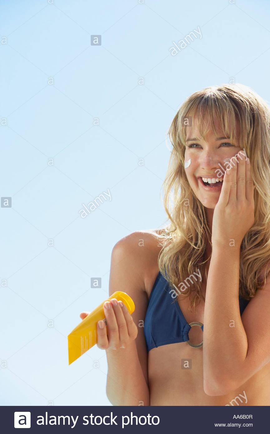 Woman in bikini with sunblock Stock Photo