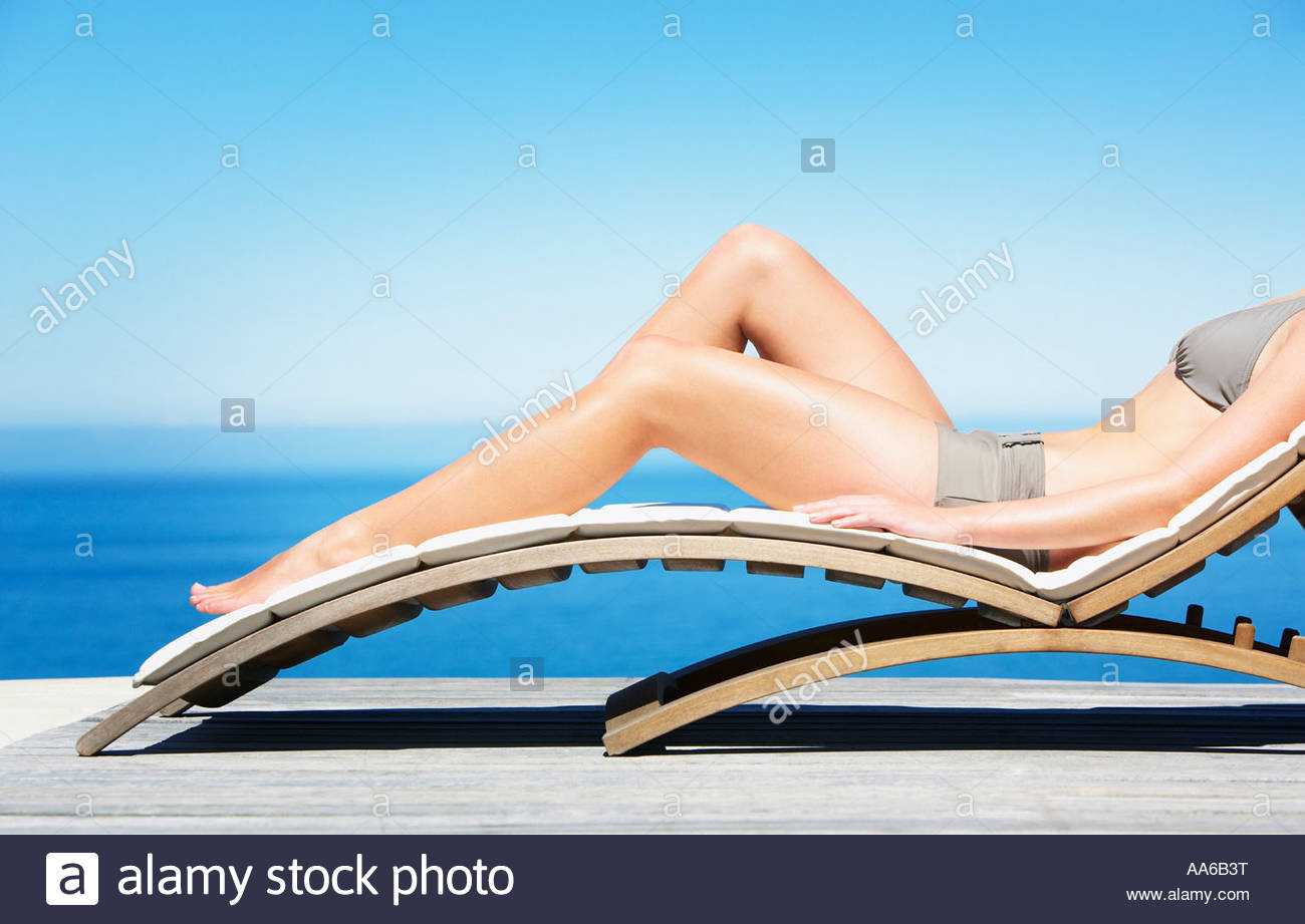 Woman Reclining On Folding Chair In Bikini Outdoors   Stock Image