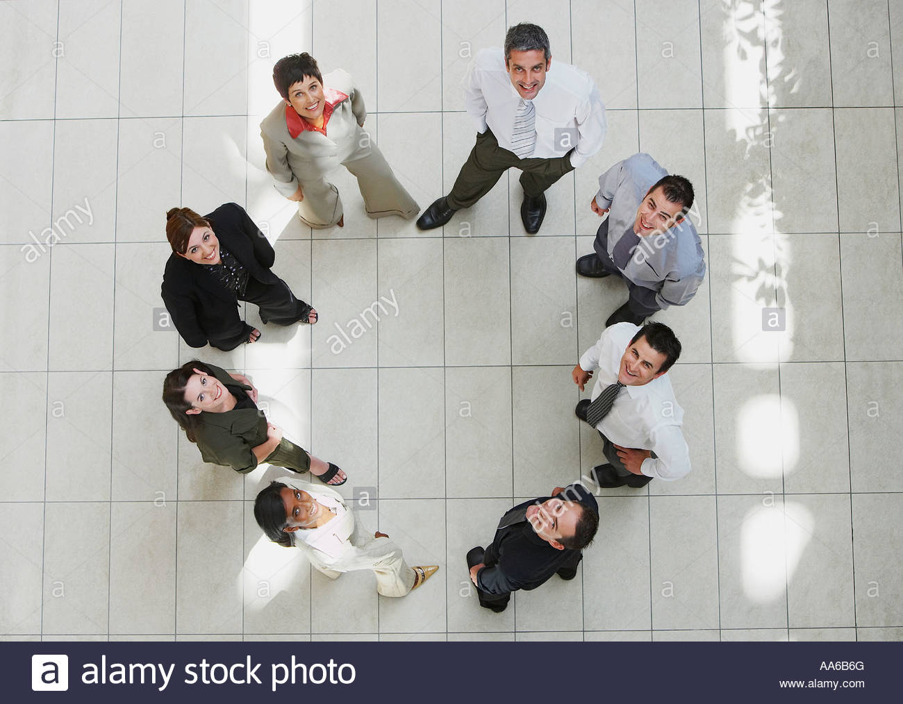 Aerial View Of Businesspeople In Circle Looking Up