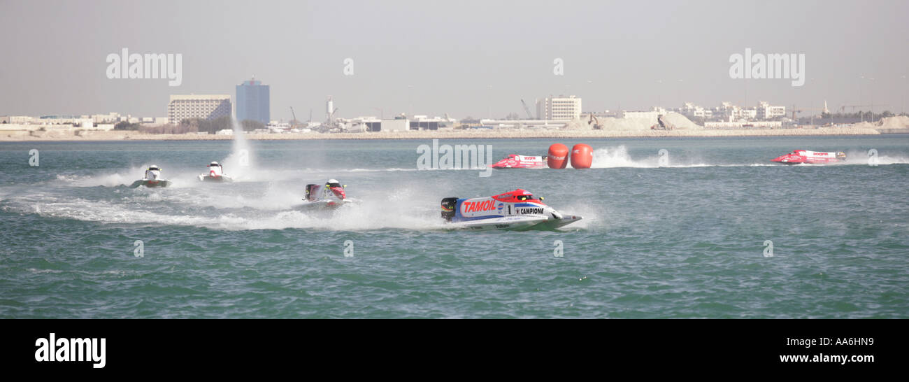 Italian Ivan Brigada s Team Tamoil powerboat leads the pack at the UIM Formula One Powerboating Championships in Doha - Stock Image