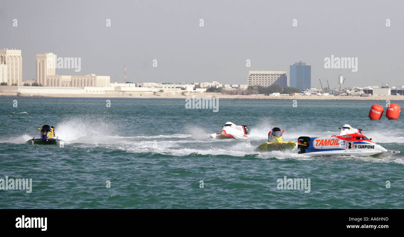 Italian Ivan Brigada s Team Tamoil powerboat in the lead at the UIM Formula One Powerboating Championships in Doha - Stock Image