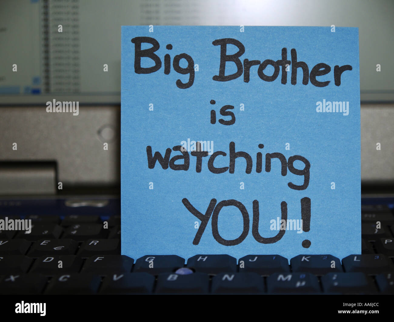 memo note on notebook, Big brother is watching you - Stock Image