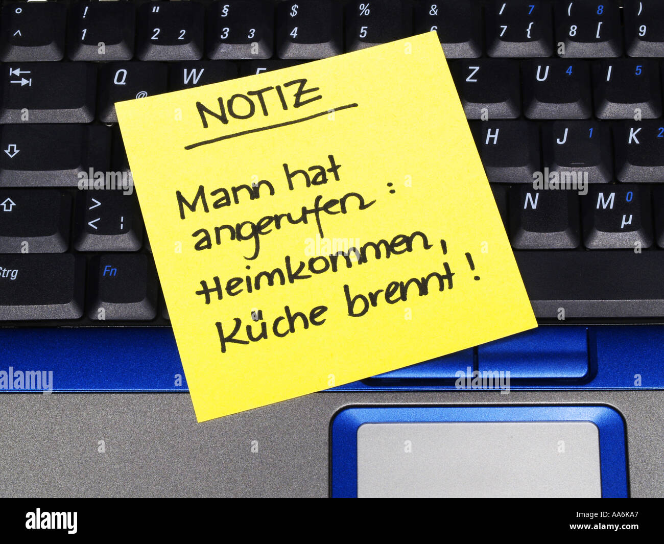 memo note on notebook note husband called coming home kitchen is burning paternity leave - Stock Image