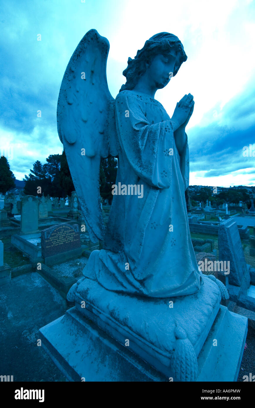 Victorian angel on a headstone in a cemetery - Stock Image