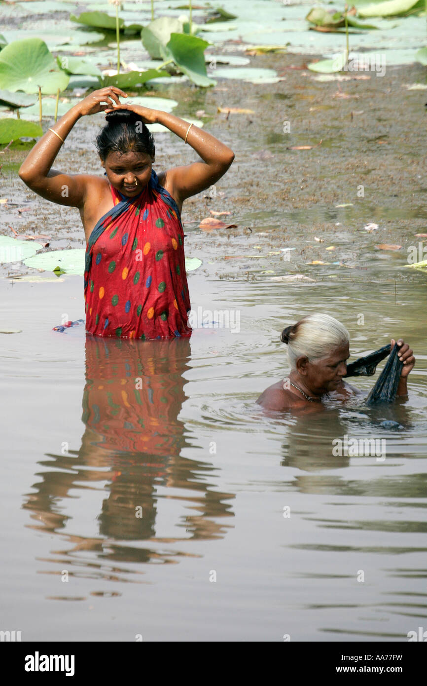 women bathing at bolgarh village orissa india stock