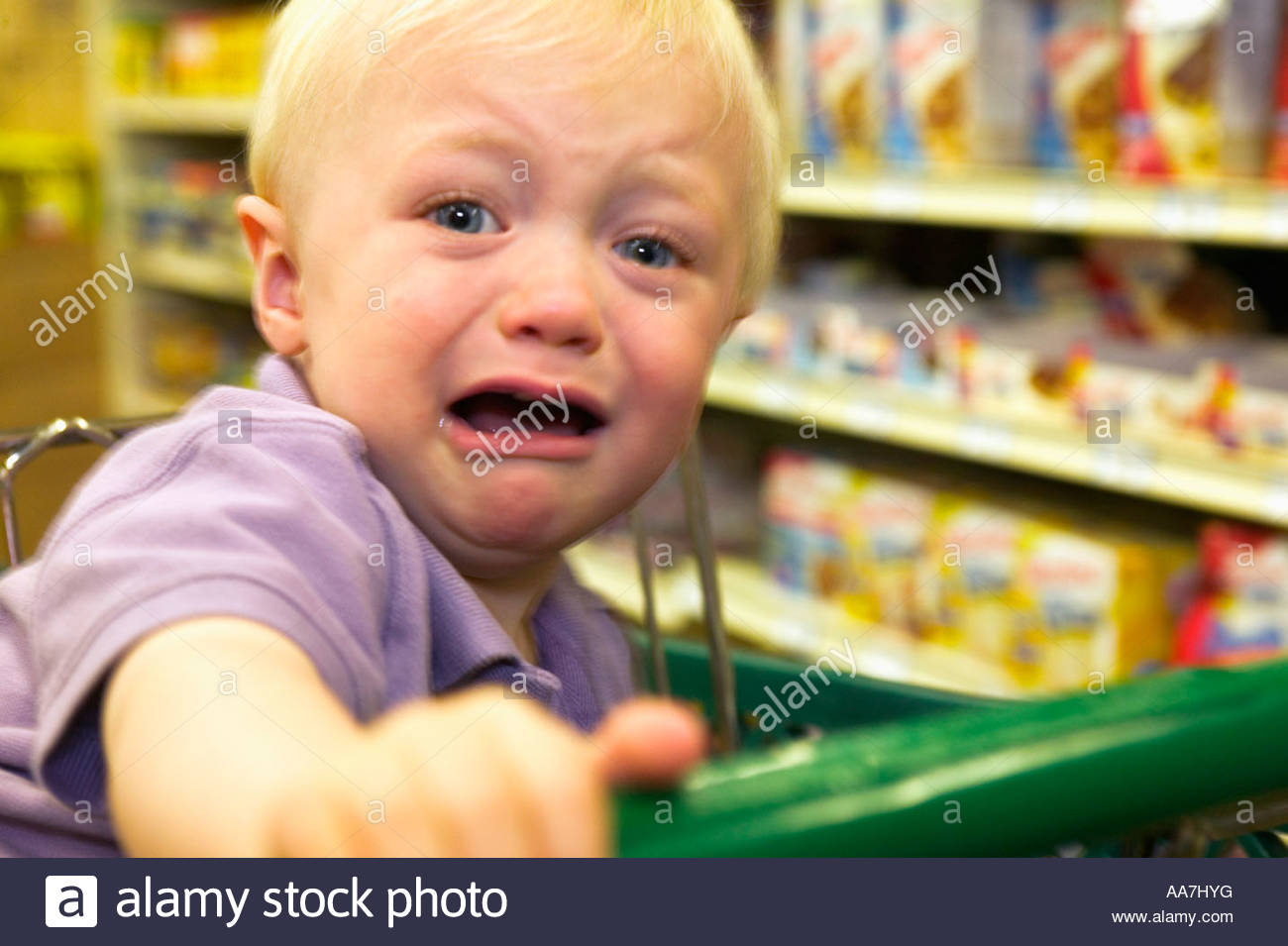 Toddler boy crying in grocery store - Stock Image