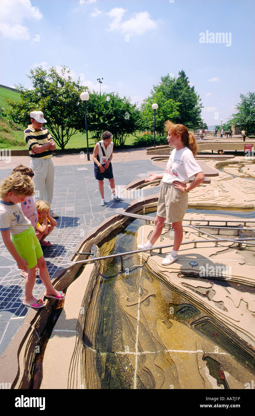 Interpreter describing scale model of the Mississippi River to visitors to The River Walk on Mud Island, Memphis, Tennessee USA - Stock Image