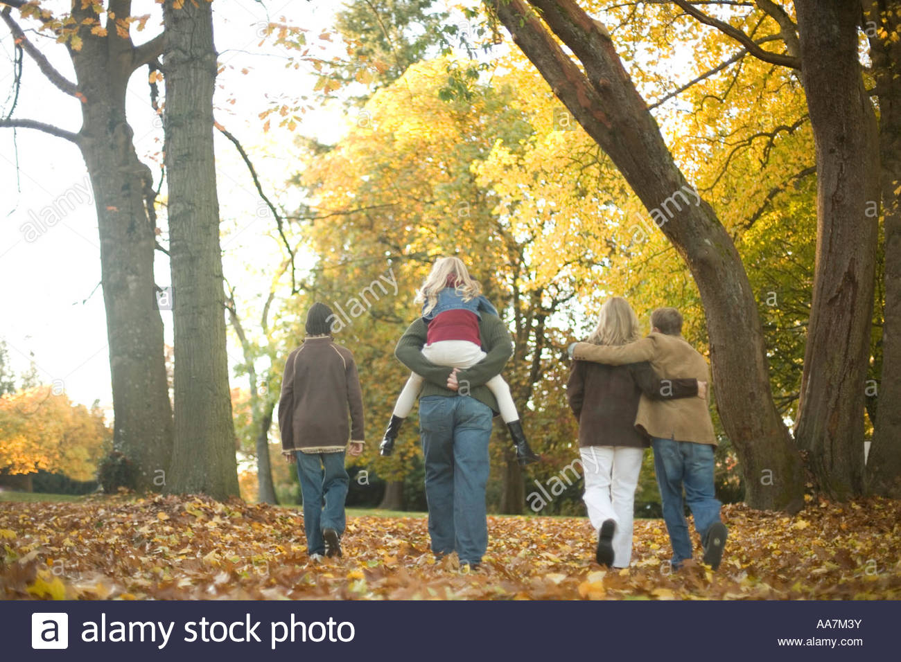 Family walking outdoors in autumn - Stock Image