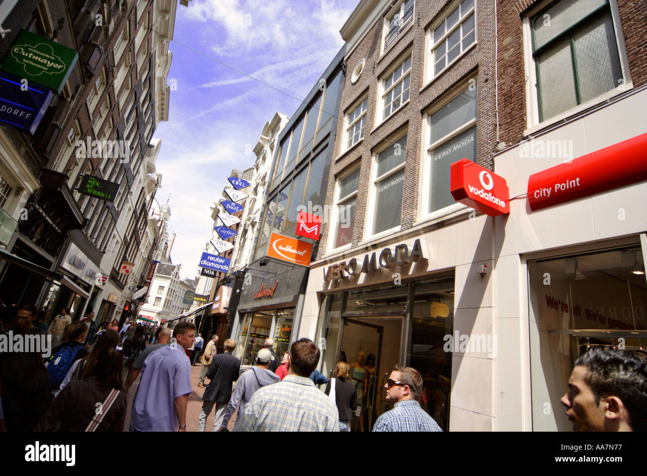 The popular shopping thoroughfare Kalverstraat in the centre of Amsterdam Holland - Stock Image