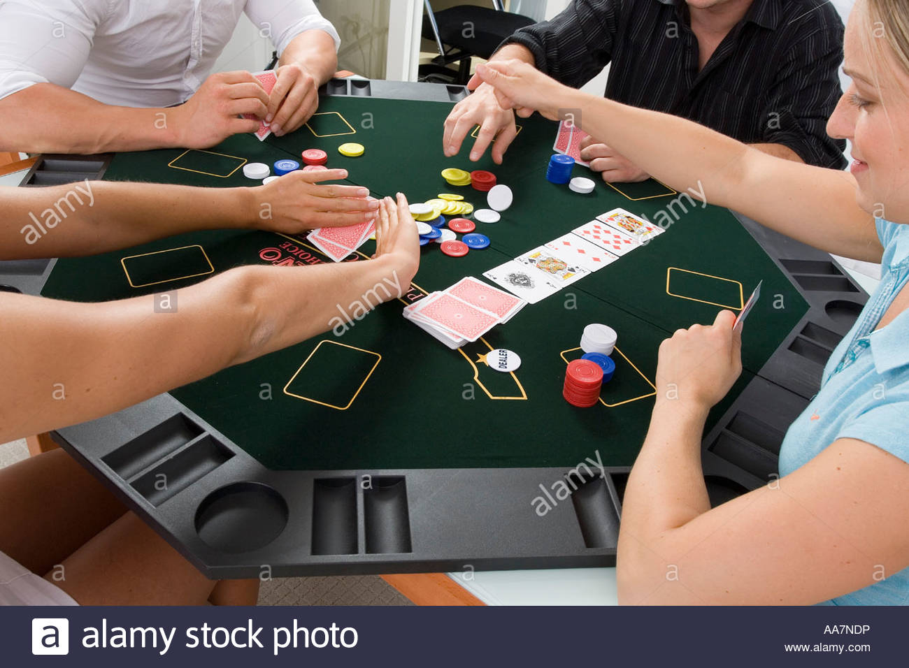 Friends playing poker at home - Stock Image