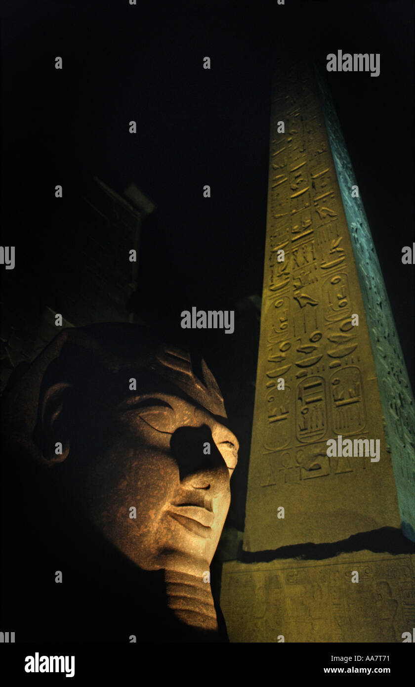 Luxor Temple at night Egyptial antiquities Luxor Egypt Ramses II s collosal head and obelisk - Stock Image