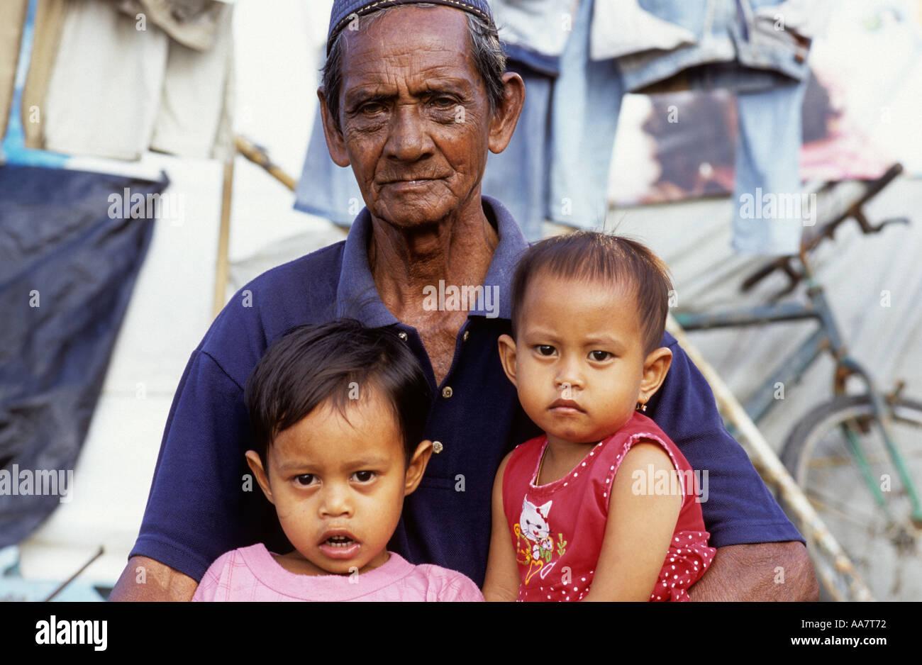 Grandfather and grandchildren survivors of the 26th Dec 04 tsunami Banda Aceh Stock Photo