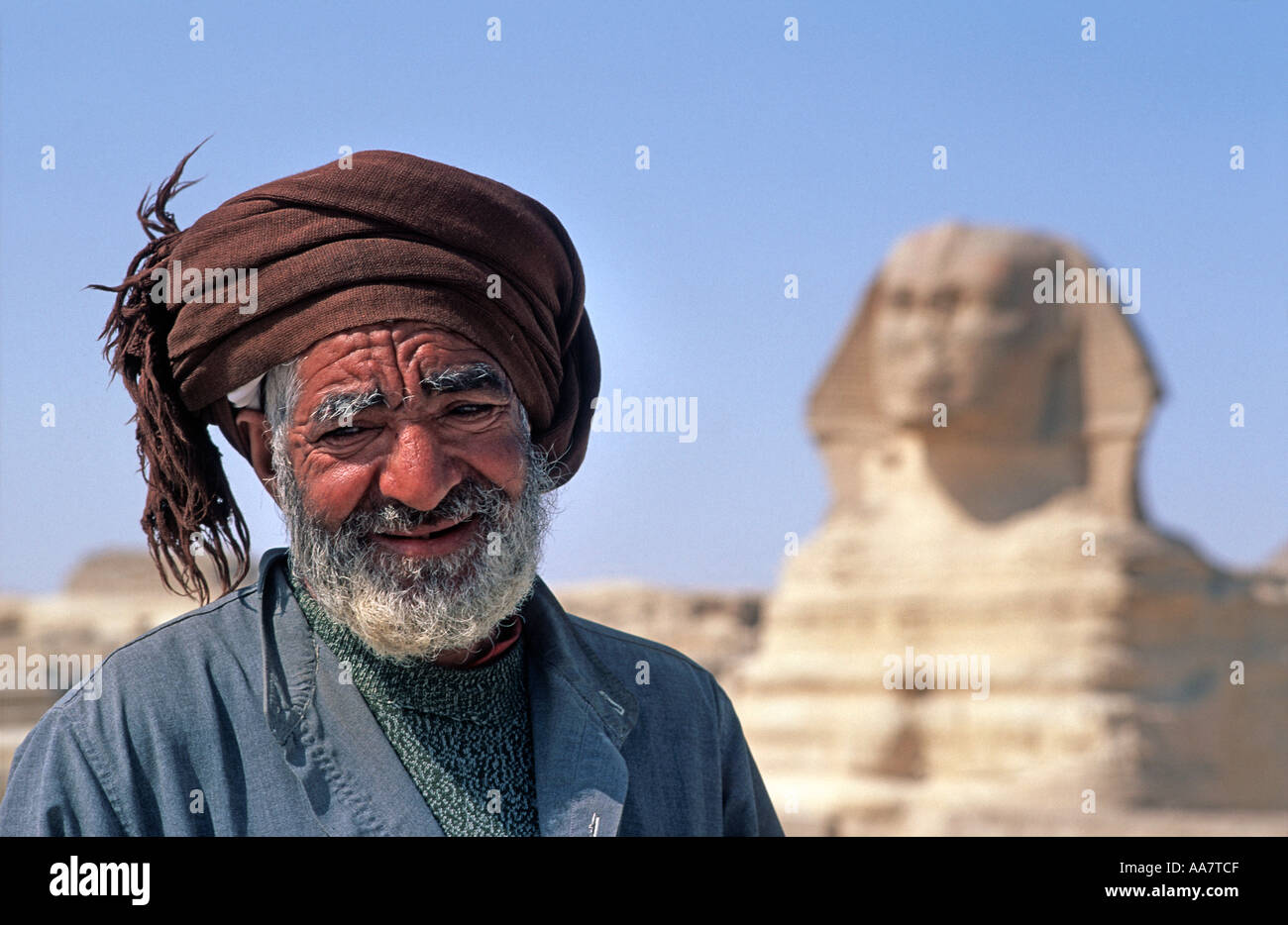 Local Egyptian guide in front of the Khephren pyramid Giza Egypt - Stock Image