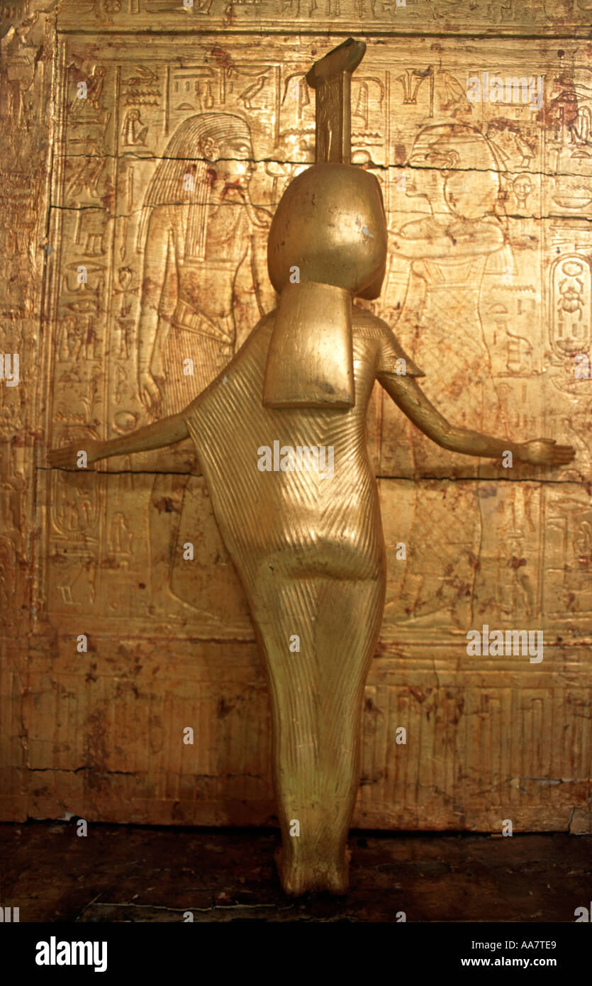 Gilded statue on a golden funerary vessel from Tutankhamun s tomb A canoptic chest Egyptian Museum Cairo Egypt - Stock Image