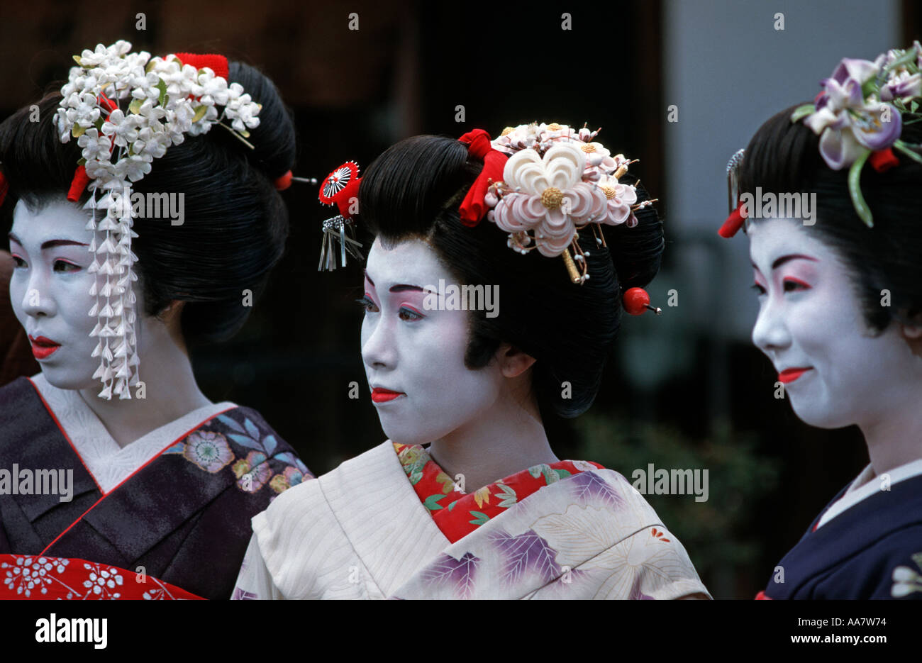 Young women dressed up as Maikos in kimonos obos Kyoto Japan - Stock Image