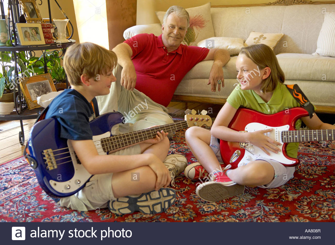 two young children learning to play guitar stock photo 12544102 alamy. Black Bedroom Furniture Sets. Home Design Ideas