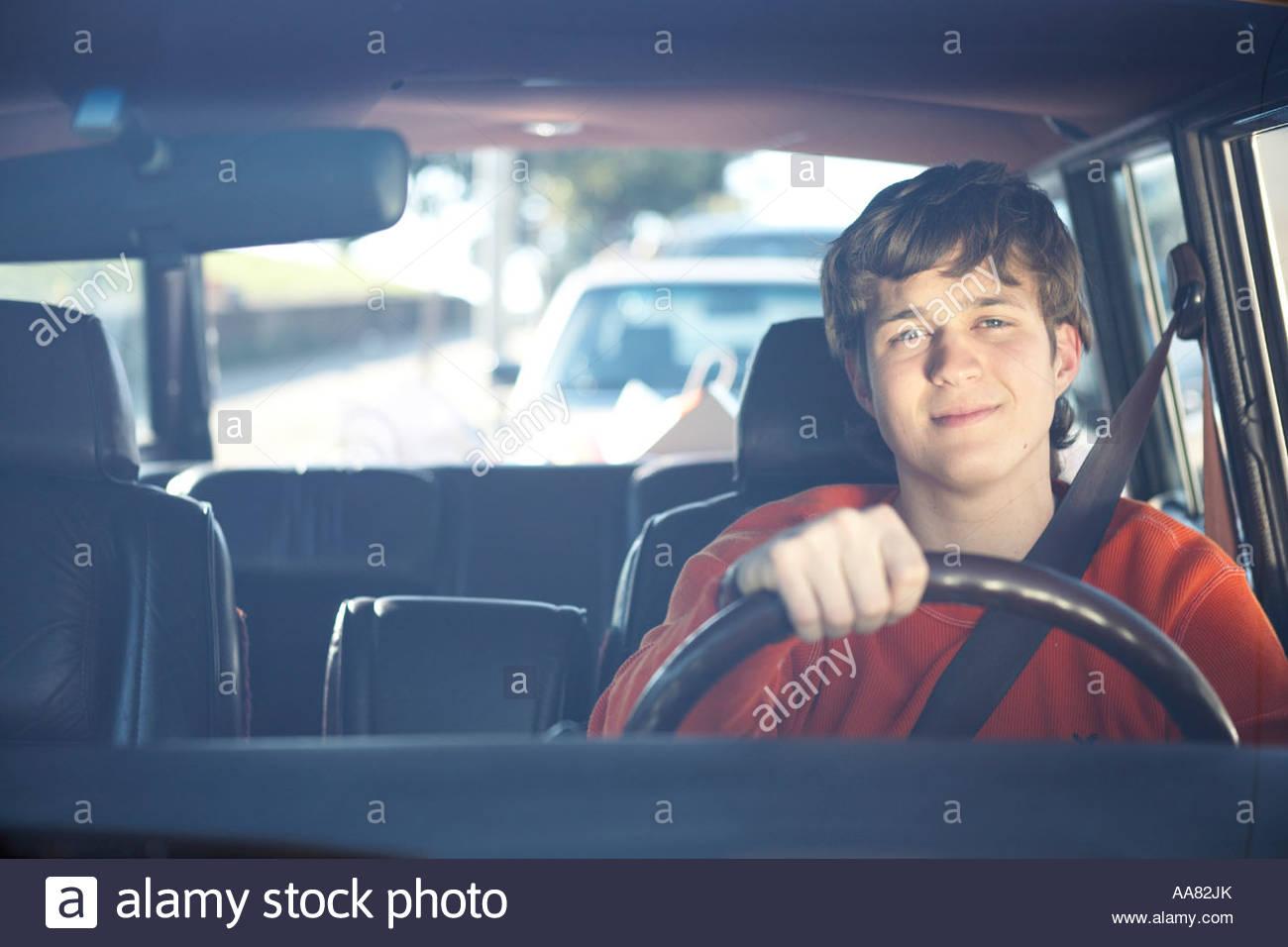 Teenage boy driving car - Stock Image