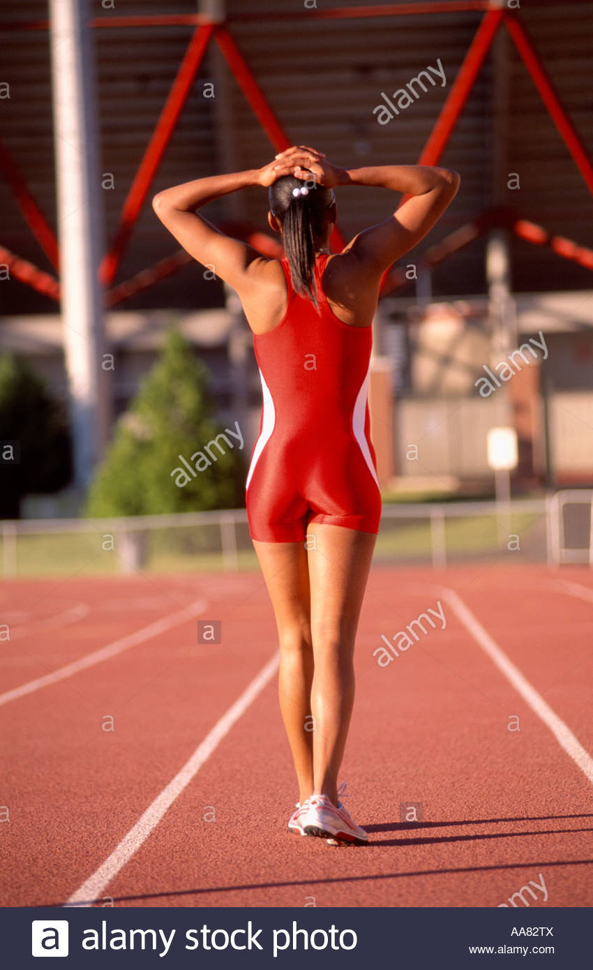 African female athlete walking on track Stock Photo
