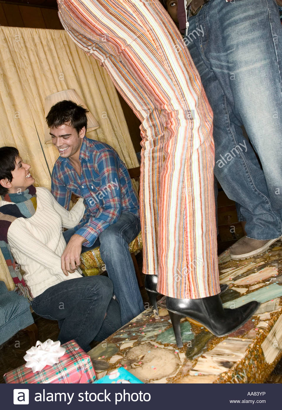 Friends at a party - Stock Image