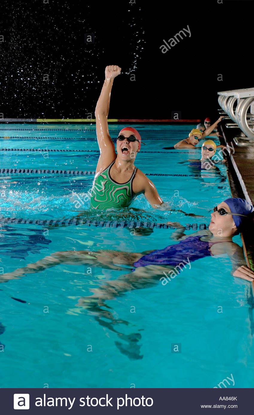 Female swimmer cheering at her victory - Stock Image