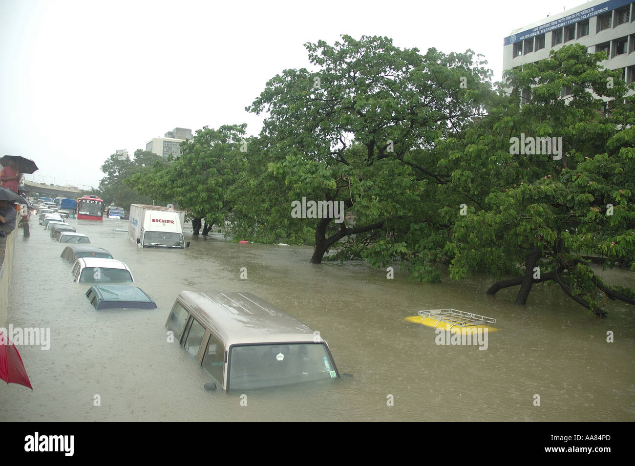 Floods due to rain showing submerged car in flooded water in Mumbai India - Stock Image