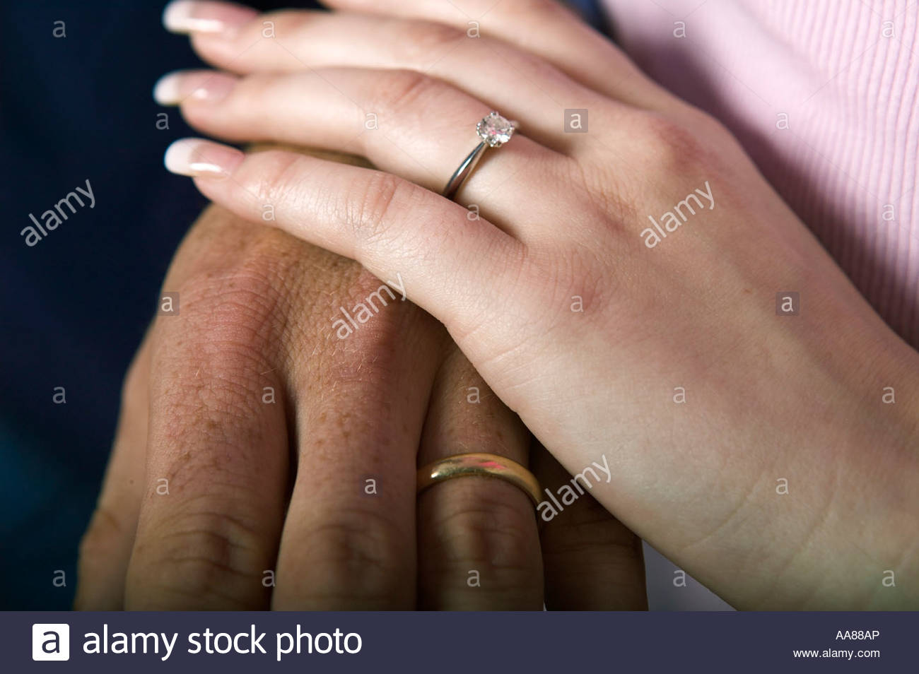 Couple wearing wedding rings holding hands stock photo 12546813 alamy couple wearing wedding rings holding hands junglespirit Gallery