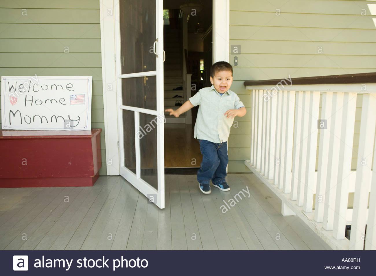 Hispanic boy running out front door  sc 1 st  Alamy & Hispanic boy running out front door Stock Photo: 12546964 - Alamy
