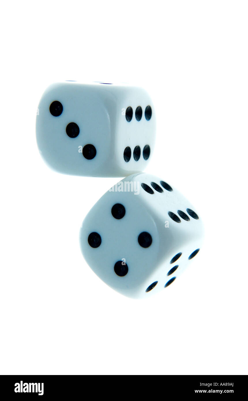 two rolled white dice with lucky seven combo of numbers - Stock Image