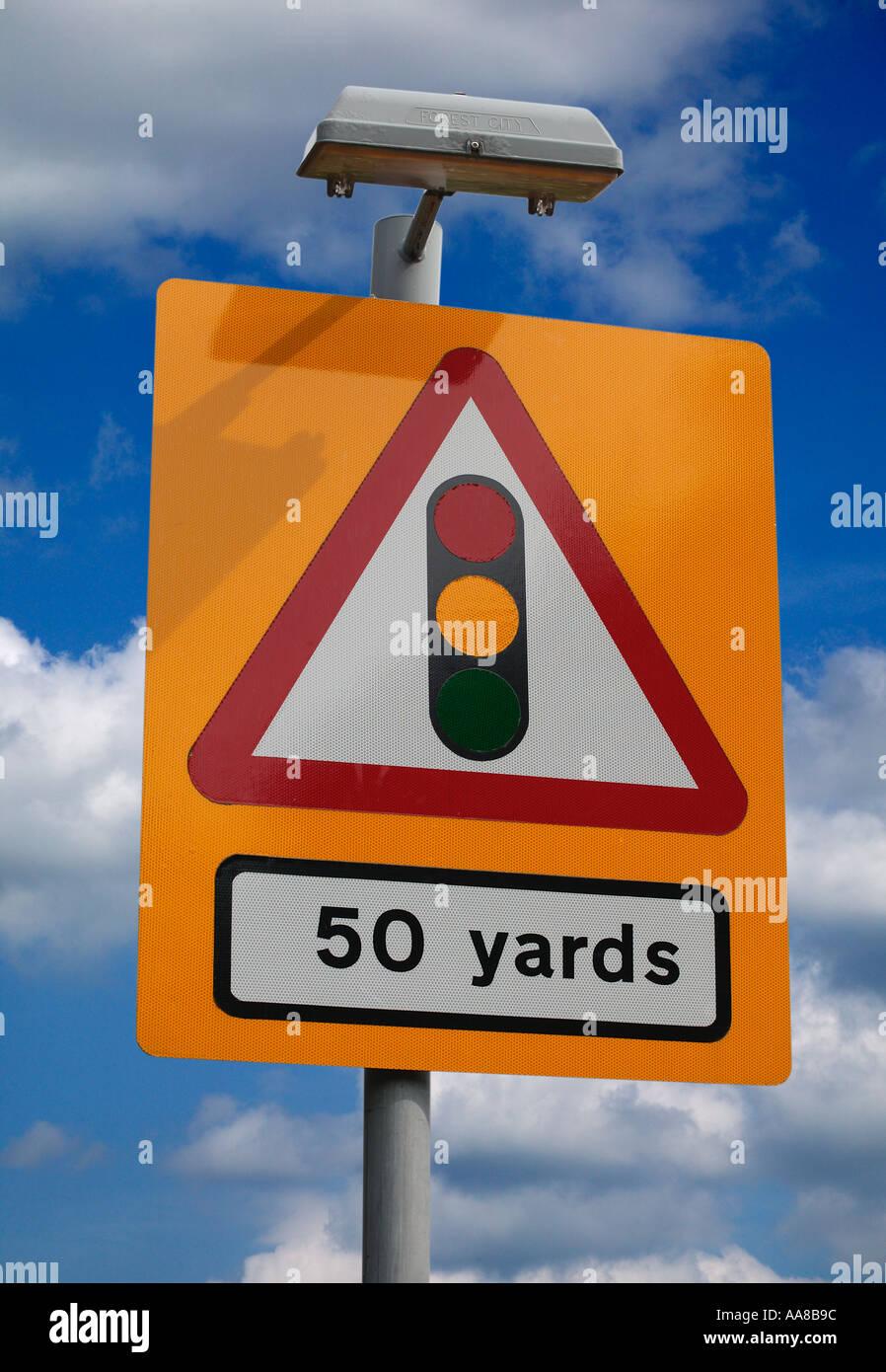 ROAD TRAFFIC LIGHT WARNING SIGN FIFTY YARDS ENGLAND UK - Stock Image