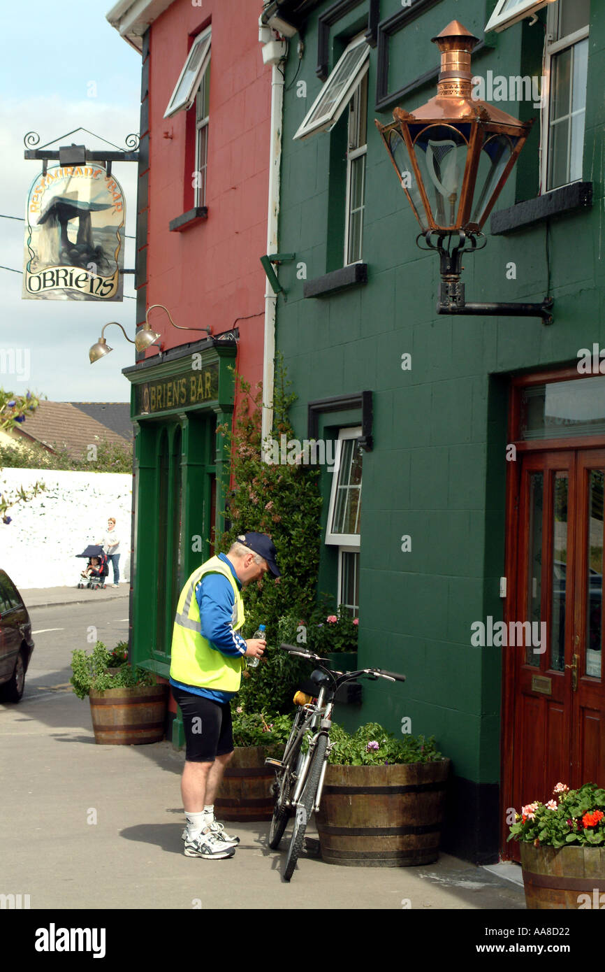 Cyclist in Ballyvaughan town centre Southern Ireland - Stock Image