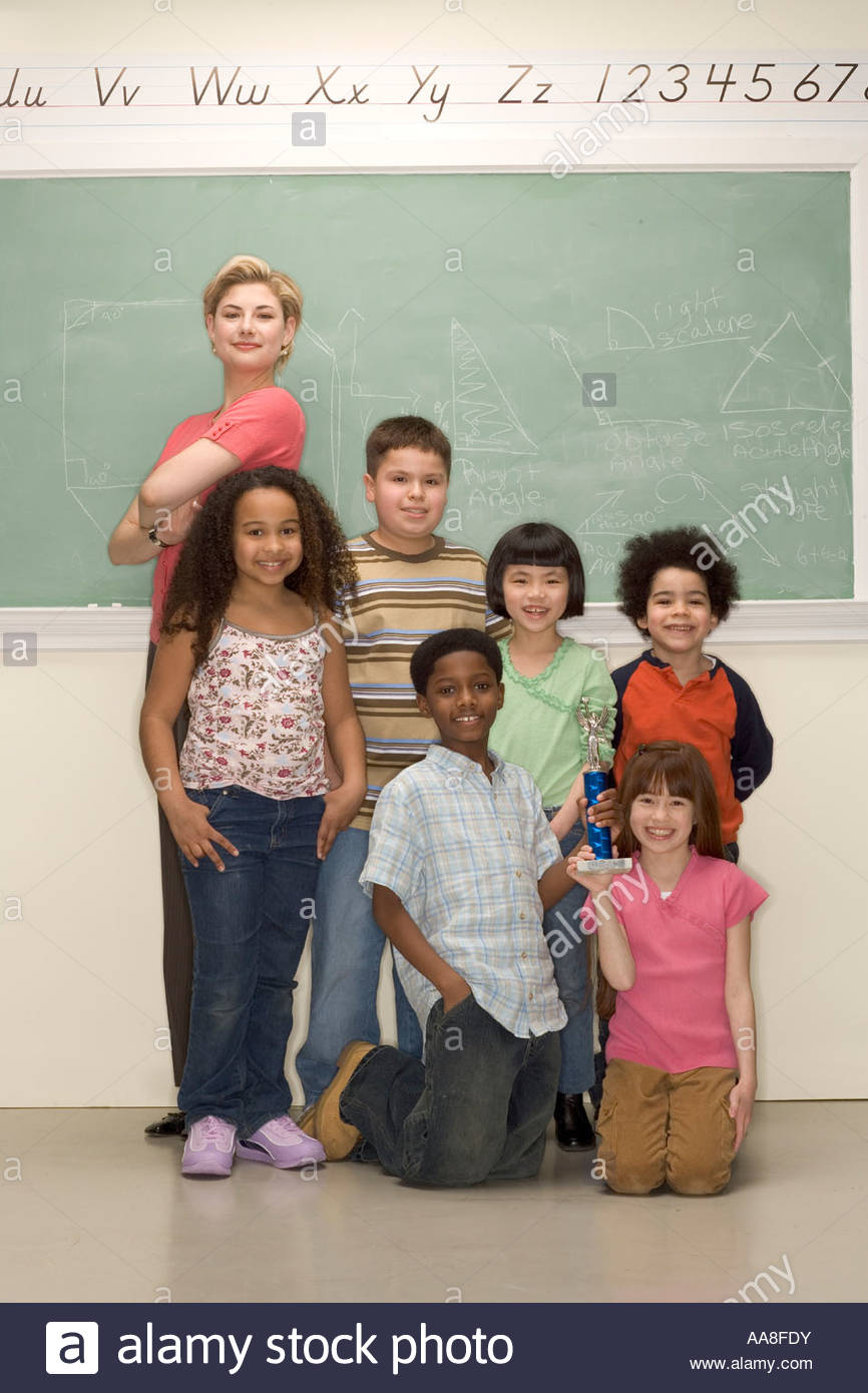 Classmates and teacher taking school picture - Stock Image