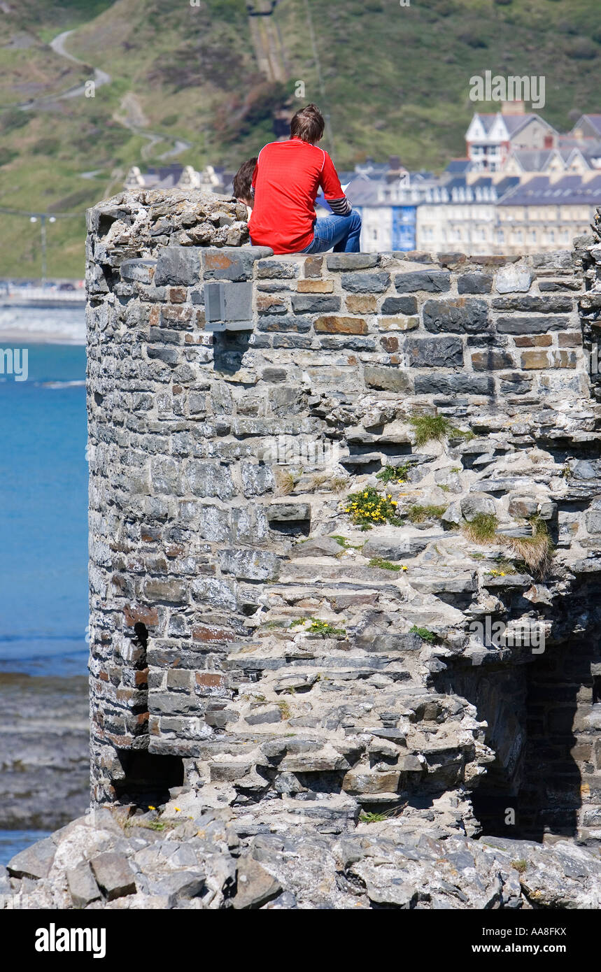 Young man at the castle at Aberystwyth County Ceredigion Wales UK May 2007 - Stock Image