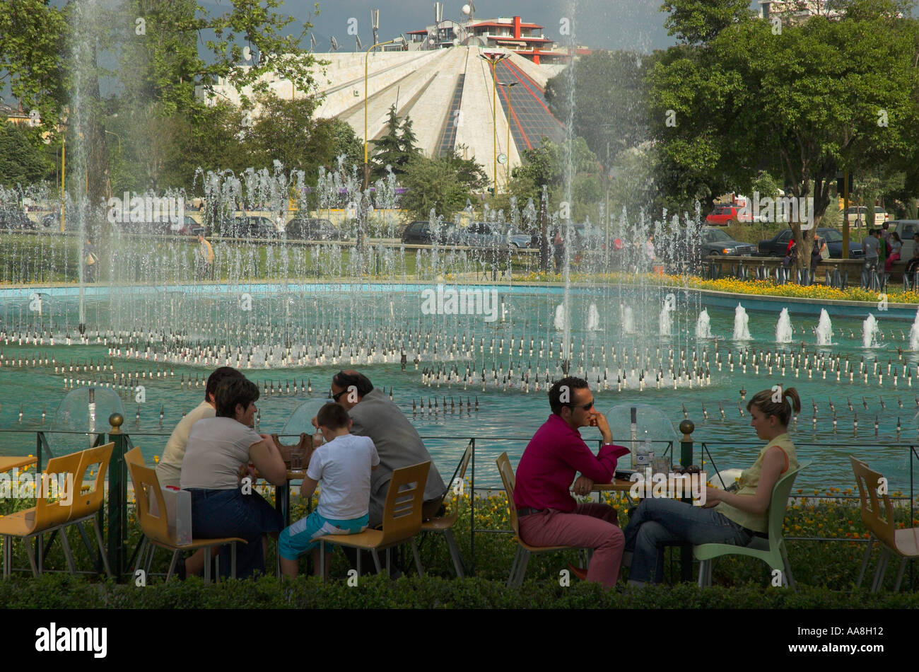 Albania Tirana Downtown Blloku cafe terrace with people and fountains in bkgd - Stock Image